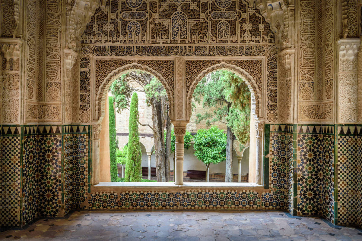 Interior view with double window and tiled walls  Alhambra palace     Interior view with double window and tiled walls  Alhambra palace  Granada   Andalusia  Spain