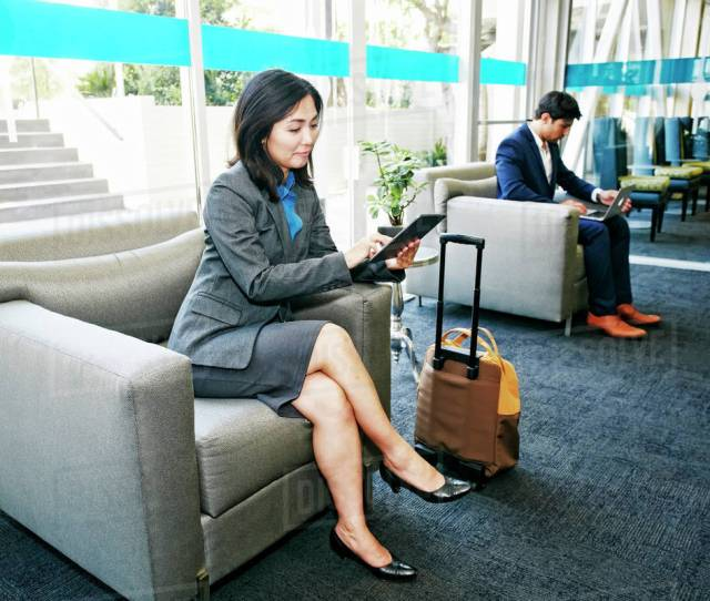 Japanese Businesswoman Using Digital Tablet In Office