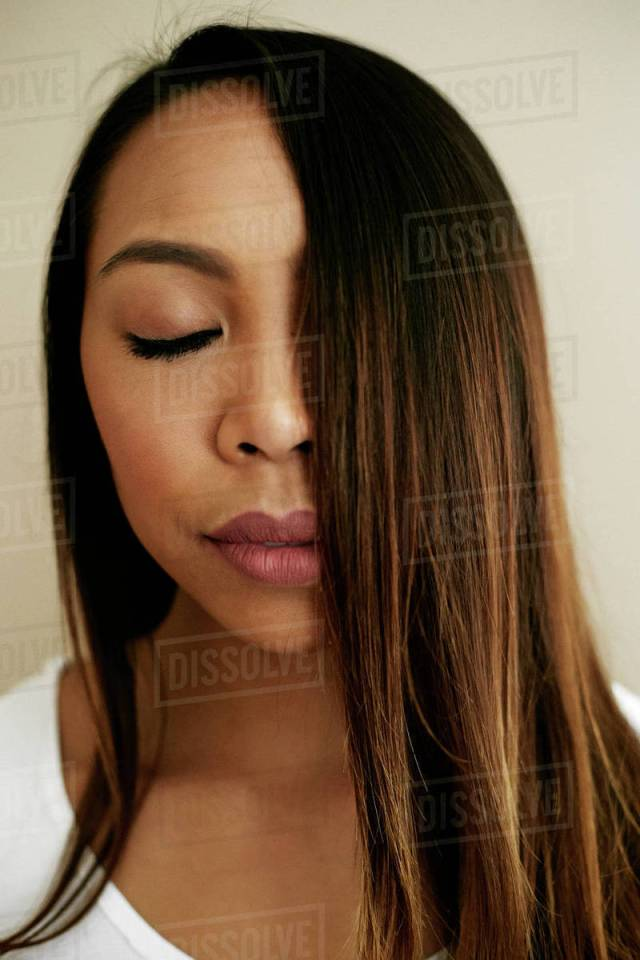hair of asian woman covering half of face stock photo