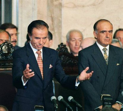 Argentine President Carlos Menem, left, acknowledges applause from lawmakers