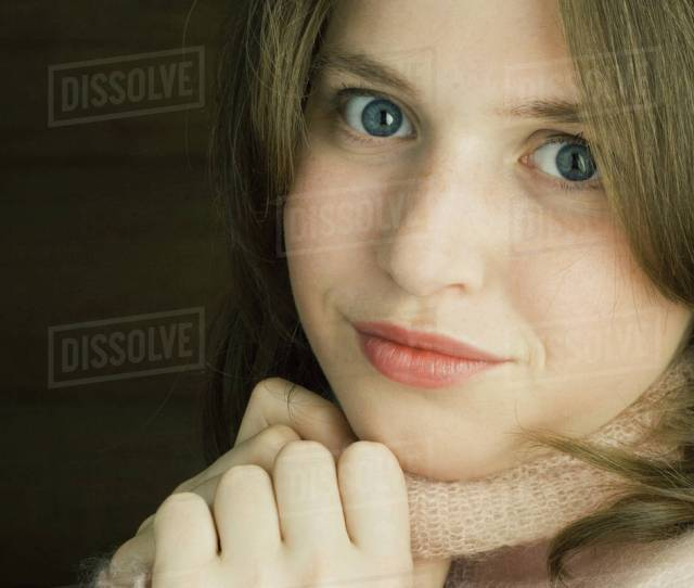 Teen Girl Holding Sweater Neck Looking At Camera Portrait