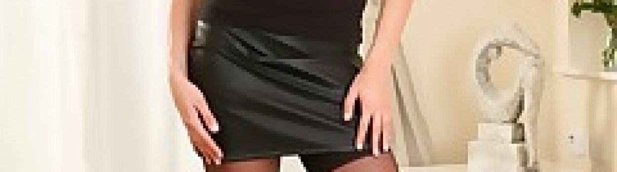 lola-wearing-tight-black-top-and-leather-miniskirt.