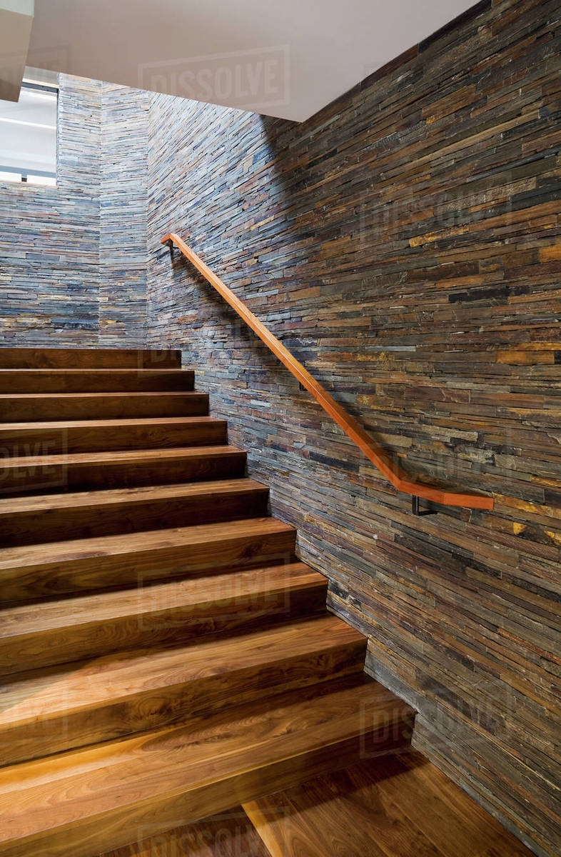 Hardwood Staircase With Stone Tile Wall Stock Photo Dissolve | Stairs Wall Tiles Design | Main Entrance Wall Tile | Exterior | Two Story House Stair | Wall Flat | Residential