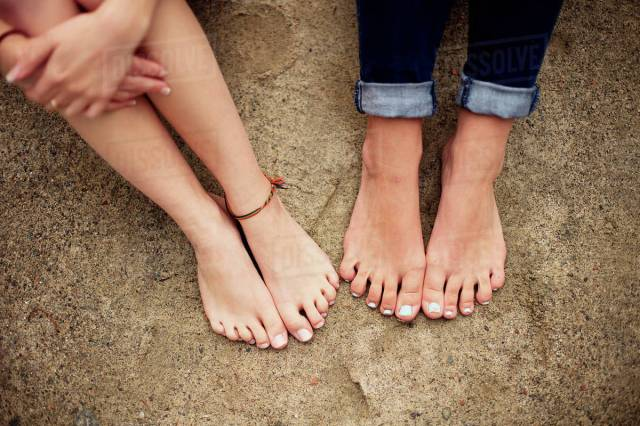 Close Up Of Barefoot Girls On Rock