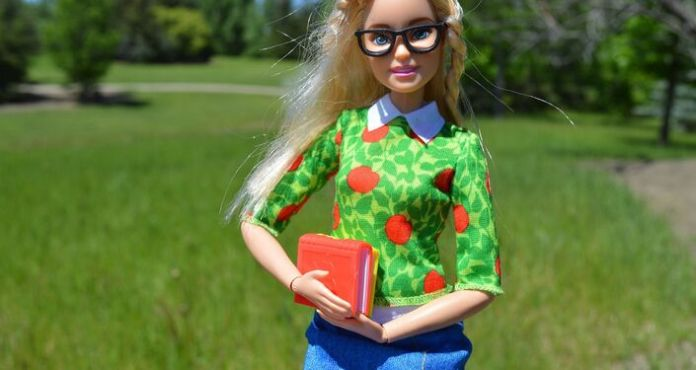 The student Barbie doll carrying her school books