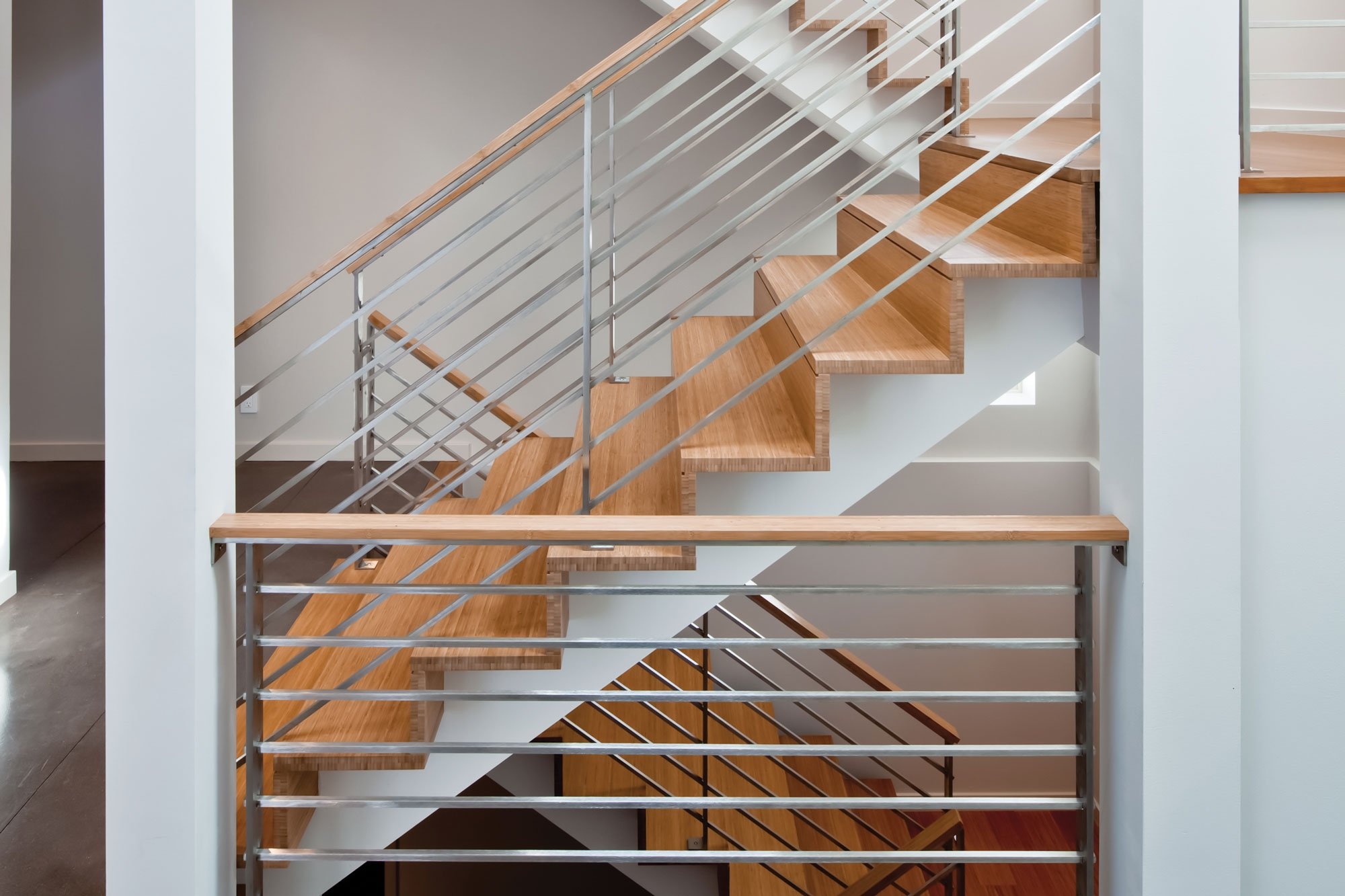 Sleek Stairs Zigzag Through Center Of Modern Remodel Remodeling   Zig Zag Staircase Design   Stringer   Dual Staircase   Chain Staircase   Sawtooth   Steel