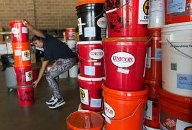 Edna Rajan stacks flood buckets from the United Methodist Committee on Relief at a United Way warehouse in Lafayette, La. Photo by Mike DuBose, UMNS