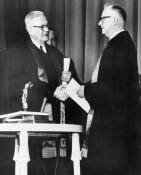 Evangelical United Brethren Church Bishop Reuben H. Mueller (left) and Methodist Bishop Lloyd C. Wicke join hands on April 23, 1968.