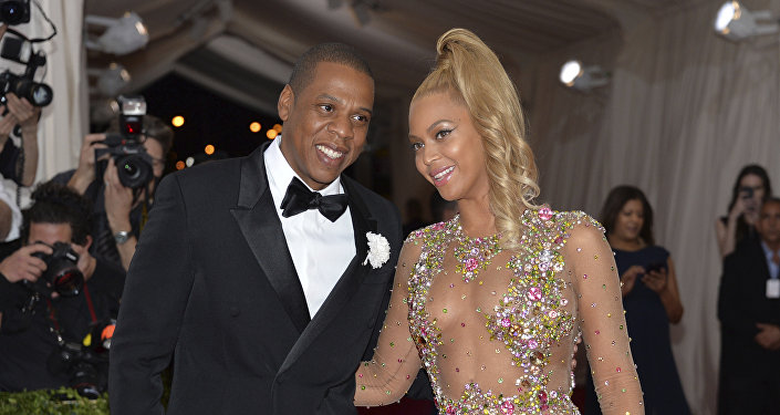 In this May 4, 2015, file photo, Jay Z, left, and Beyonce arrive at The Metropolitan Museum of Art's Costume Institute benefit gala celebrating China: Through the Looking Glass in New York