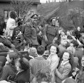 The West Nova Scotia Regiment traveling to Rotterdam are surrounded by happy Dutch civilians. May 9, 1945.