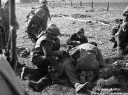 Canadian troops aid one of their wounded by a German sniper near the Afwalnings Canal on April 7, 1945.