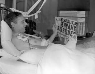 A patient at Shaughnessy Hospital in Vancouver reads about the good news.
