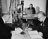 Prime Minister William Lyon Mackenzie King and future Prime Minister Louis St. Laurent broadcast a joint statement from the UN Conference in San Francisco on May 8, 1945.