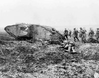 2nd Canadian Division soldiers advance behind a tank