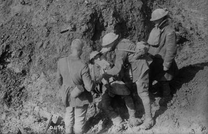 A wounded Canadian receives first aid at Vimy Ridge.