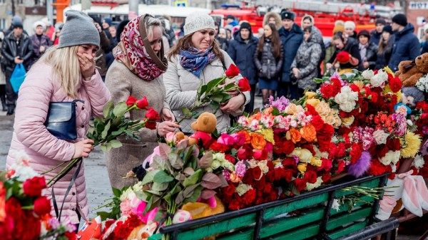 Russia mourns victims of blaze in Kemerovo 64 dead