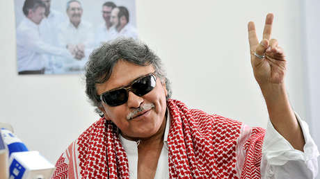 Commander of the FARC-EP leftist guerrillas Jesus Santrich gestures during a press conference in Bogota on December 6, 2016, held to talk about the guerrillas' mobilization to their final concentration zones