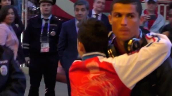Young Ronaldo fan breaks through security to hug his hero ...