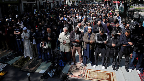 Muslims pray during Friday prayers in the street in front of the city hall of Clichy, near Paris, France. © Benoit Tessier