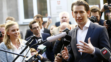 Top candidate of Peoples Party (OeVP) and Foreign Minister Sebastian Kurz talks with journalist after leaving a polling station in Vienna, Austria October 15, 2017. © Leonhard Foeger