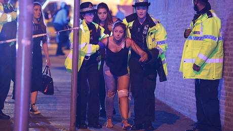 FILE PHOTO: An injured concert-goer is helped by police and emergency responders at the Manchester Arena after reports of an explosion, Manchester, England © Joel Goodman / Global Look Press