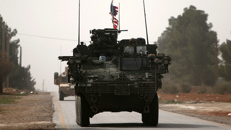 FILE PHOTO: American army vehicles drive north of Manbij city, in Aleppo Governorate, Syria March 9, 2017. ©Rodi Said
