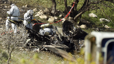 A picture shows the remains of an Israel F-16 that crashed after coming under fire by Syrian air defences during attacks against