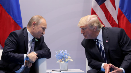 Russian President Vladimir Putin talks to US President Donald Trump during their bilateral meeting at the G20 summit in Hamburg, Germany, on July 7, 2017. © Carlos Barria / Reuters
