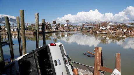 5bc7ec47dda4c8ff678b45ea Florida cops struggle to stop armed looters as hurricane Michael death toll reaches 33