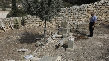 5bc8ed72fc7e93511f8b4623 Vandals destroy Christian cemetery in Israel in apparent hate crime