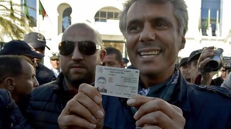 5c7ef30efc7e93b54a8b45d5 President's double: Eccentric businessman hatches bold plan to skirt law & lead Algeria