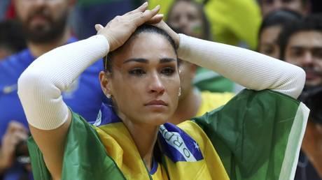 5cc08f25dda4c8875f8b456f Brazilian volleyball star faints midway through live court-side interview (VIDEO)