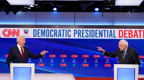 Democratic U.S. presidential candidates former Vice President Joe Biden and Senator Bernie Sanders debate during the 11th Democratic candidates debate of the 2020 U.S. presidential campaign, U.S., March 15, 2020. © REUTERS/Kevin Lamarque