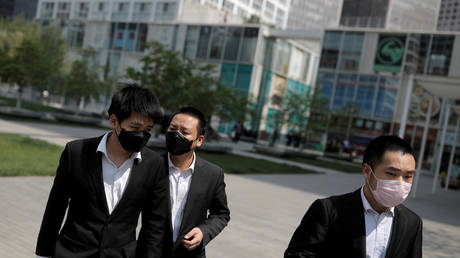 Office workers wear protective gear near Beijing's Central Business District as the spread of the new coronavirus disease continues in China
