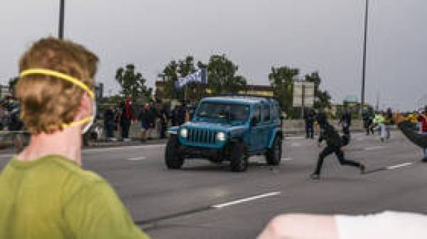 Protester shoots fellow demonstrator while aiming at car that sped through crowd on highway in Aurora, Colorado (VIDEO)
