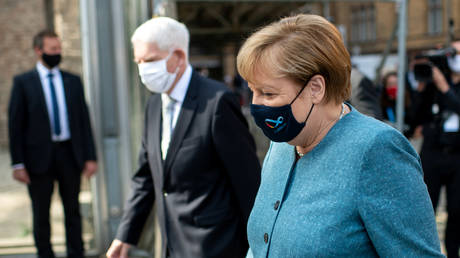 Chancellor Angela Merkel and President of Jewish Community Josef Schuster arrive for an event marking the 70th anniversary of the Central Council of Jews in Germany's founding in Berlin, September 15, 2020.