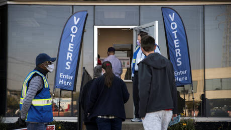 FILE PHOTO: People line up to cast their ballots for the upcoming presidential election as early voting begins in Cincinnati, Ohio, October 6, 2020.