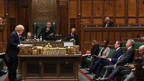 Britain's Prime Minister Boris Johnson faces opposition leader Keir Starmer, House of Commons, London, Britain (FILE PHOTO) © UK Parliament/Jessica Taylor/Handout via REUTERS
