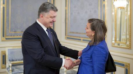 Victoria Nuland is shown greeting Ukrainian President Petro Poroshenko in 2015.