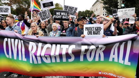 LGBTQ activists and supporters block the street outside the U.S. Supreme Court