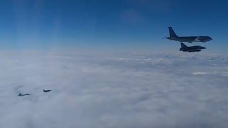 A Russian Su-27 (bottom left) intercepting two French Mirage fighters and an air tanker over the Black Sea, February 17, 2021