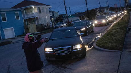 Residents line up to enter a warming center and shelter after record-breaking winter temperatures knocked out power for hundreds of thousands of Texans, in Galveston, Texas, February 17, 2021.