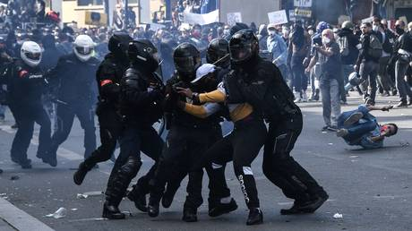 FILE PHOTO: French riot police forces detain a protester during a rally as part of the 'Black Lives Matter' worldwide protests against racism and police brutality, on Place de la Republique in Paris on June 13, 2020