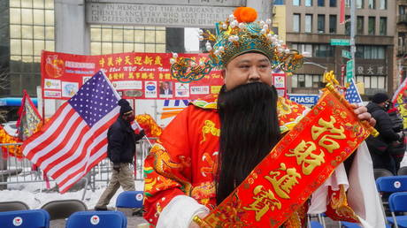 A man in a Chinese costume celebrates the Lunar New Year in the Chinatown area of Manhattan, New York City, February 12, 2021.