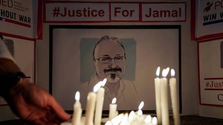 Activists hold a candlelight vigil for Jamal Khashoggi at the embassy of Saudi Arabia in Washington, DC, October 2, 2019.