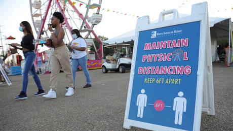 FILE PHOTO: A sign reminding attendees to practice social distancing is seen at the entrance of the Mississippi State Fair, in Jackson, Mississippi, October 7, 2020.