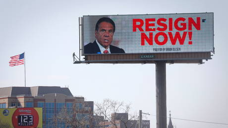 """An electronic billboard displays a message that reads """"Resign Now"""" for New York Governor Andrew Cuomo in the wake of allegations that he sexually harassed young women, in Albany, New York, US, March 3, 2021."""