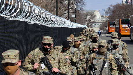 National Guard soldiers patrol the compound around the US Capitol after police warned that a militia group might try to attack the Capitol complex in Washington, DC, March 4, 2021.