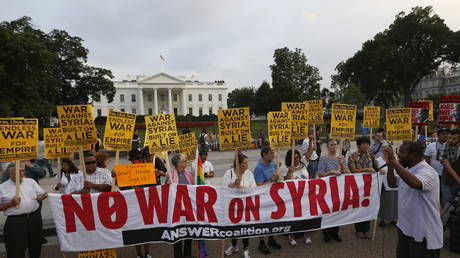 """FILE PHOTO: The """"Act now to stop war and end racism"""" (ANSWER) coalition holds a rally against the US-led military action on Syria outside the White House in Washington, August 29, 2013"""