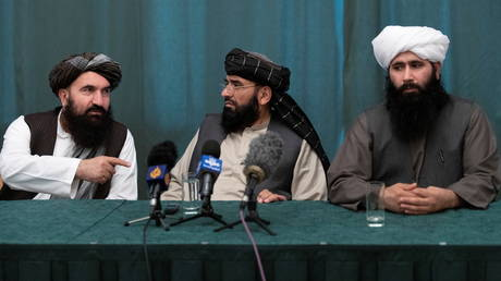 Khairullah Khairkhwa, Suhail Shaheen, Mohammad Naeem attend a joint news conference in Moscow on Taliban peace talks